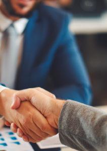 shaking hands over surety bond agreement
